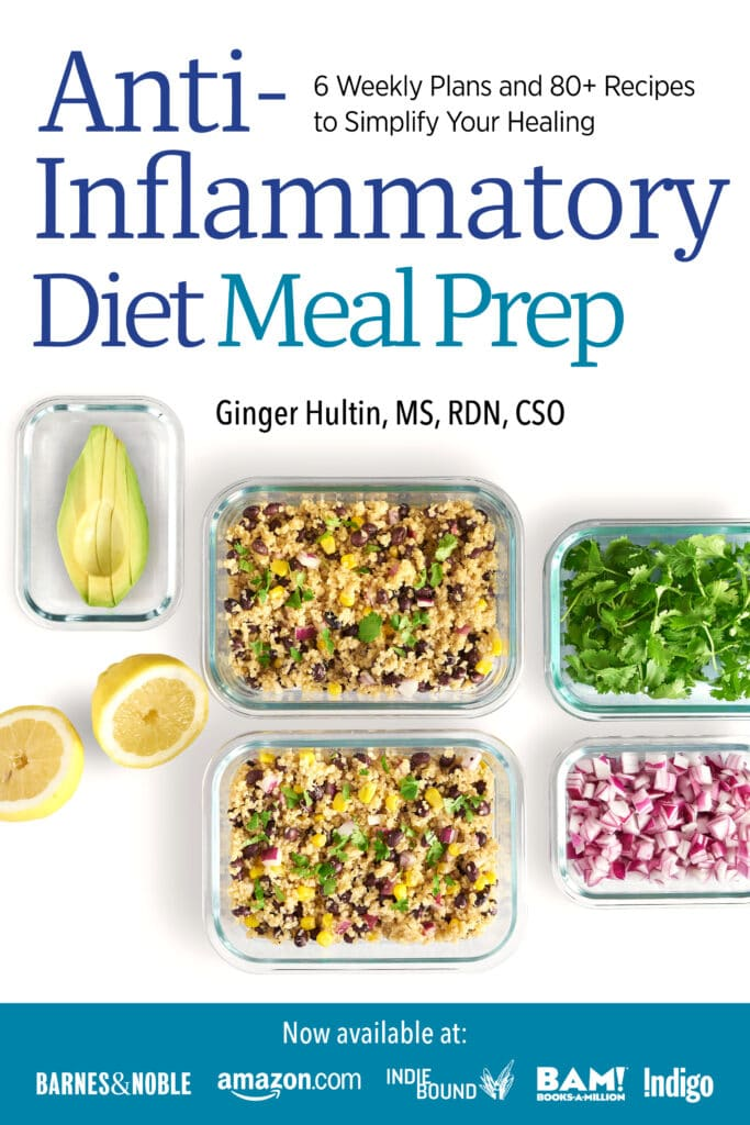 A meal prep book with a white and blue cover full of healthy food